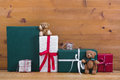 Christmas presents and gift boxes with teddy bears on wooden bac Royalty Free Stock Photo