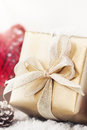 Christmas presents or gifts with elegant bow and christmas decorations on bright snowy background Royalty Free Stock Photo