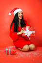 Christmas presents joy studio portrait of a young woman enjoying gifts Stock Image