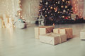 Christmas presents in living room under new year tree Royalty Free Stock Photo