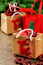 Christmas presents next to festive fir tree Stock Photos