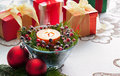 Christmas presents with red bauble decoration and candle Stock Photos