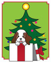 Christmas puppy being given as a gift is ready to get out of the box Royalty Free Stock Photos