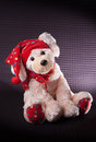 Christmas puppy dog plush toy a isolated on a dark patterned background with copy space Stock Photos