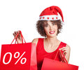 Christmas purchases beautiful woman in santa claus red hat with red packages Royalty Free Stock Images