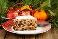 Christmas raising cake on white plate with fur tree and christma toys wood table Royalty Free Stock Photos