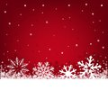 Christmas red background on a winter theme with a beautiful falling snow Royalty Free Stock Photos