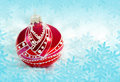 Christmas red ball on blue background Stock Images