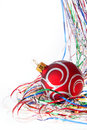 Christmas red ball among colored tinsel over white Stock Image