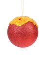 Christmas red ball covered amber crumbs isolated on a white background Royalty Free Stock Photos