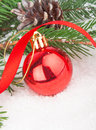 Christmas red ball on fir tree branch celebration decoration Stock Photo