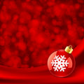 Christmas red ball on silk Royalty Free Stock Photography