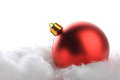 Christmas red balls on artificial snow with white background Royalty Free Stock Photography