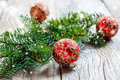 Christmas red balls with gold ornaments and spruce branch. Royalty Free Stock Photo