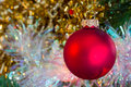 Christmas red bauble with sparkly tinsel Royalty Free Stock Photo