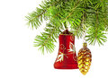 Christmas red bell and golden cone  on new year tree Royalty Free Stock Image