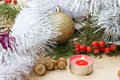 Christmas red candle on wooden table among christmas and new year ball and decor close up Royalty Free Stock Photo