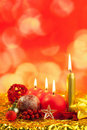 Christmas red candles on golden bokeh lights Stock Images
