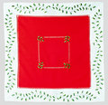 Christmas red cloth embroidered with holly Royalty Free Stock Photo