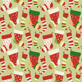 Christmas red and green socks seamless pattern greeting card with vector illustration with Royalty Free Stock Images