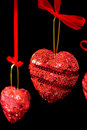 Christmas red hearts hanging Stock Images