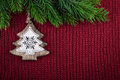 Christmas red knitted background with christmas tree decoration in country farmhouse style Royalty Free Stock Photo