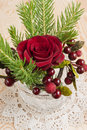 Christmas red rose and berries decorations. Royalty Free Stock Photo