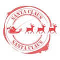 Christmas stamp with Santa Claus in a sleigh rides on deer Royalty Free Stock Photo