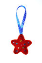 Christmas red star of felt Stock Photos