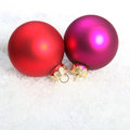 Christmas red and violet globes in snow Stock Photos