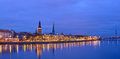 Christmas riverside view of old city of riga latvia evening Stock Photos