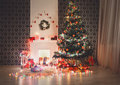 Christmas room interior design, decorated tree in garland lights Royalty Free Stock Photo