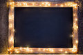 Christmas rustic background - vintage planked wood with lights a Royalty Free Stock Photo