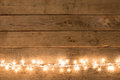 Christmas rustic background - vintage planked wood with lights and free text space Royalty Free Stock Photo