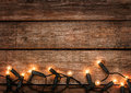 Christmas rustic background vintage wood with lights planked and free text space Royalty Free Stock Photography