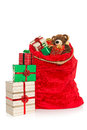 Christmas sack isolated on white a red full of gift wrapped presents and toys a background Stock Images