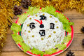 The Christmas salad rice olives greens peas - concept New year clock face, midnight, brown wooden background spruce Royalty Free Stock Photo