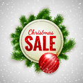 Christmas sale advertising white banner decorated with fir branches and red bauble on show background, winter sale
