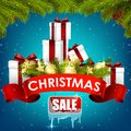 Christmas sale background with gift boxes, golden balls, pine tree and realistic ribbon