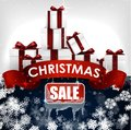 Christmas sale background with red realistic ribbon banner and gift boxes Royalty Free Stock Photo
