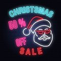 Christmas sale neon sign with santa claus. Vector illustration.