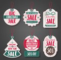 Christmas sale price tags vector set with different discount text and shapes Royalty Free Stock Photo