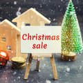 Christmas Sale of Real Estate. New Year discounts for buying housing. Purchase apartments at a low price. Holiday discounts. Royalty Free Stock Photo