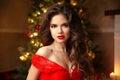Christmas Santa. Beautiful smiling woman model. Makeup. Healthy Royalty Free Stock Photo