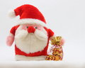 Christmas santa card stock photo with gifts bag on white snow background Royalty Free Stock Photography