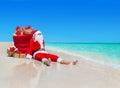 Christmas Santa Claus with gift boxes sack at tropical beach Royalty Free Stock Photo