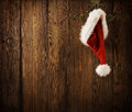 Christmas Santa Claus Hat Hanging On Wood Wall, Xmas Concept Royalty Free Stock Photo