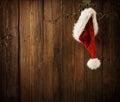 Christmas Santa Claus Hat Hanging On Wood Wall, Xmas Concept
