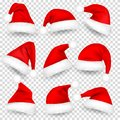Christmas Santa Claus Hats With Fur and Shadow Set. New Year Red Hat Isolated on Transparent Background. Winter Cap Royalty Free Stock Photo