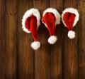 Christmas Santa Claus Hats Hanging on Wood, Xmas Family Royalty Free Stock Photo